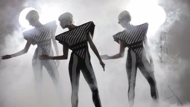 Futuristic Dancers In Smoky Background: Stock Video