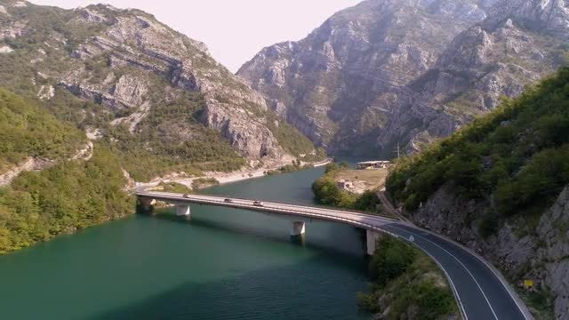 Cars Traverse Bridge Over Water: Stock Video