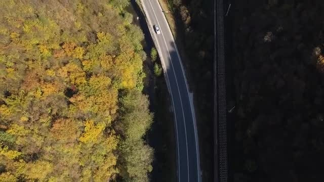Flying Over Road And Railway: Stock Video