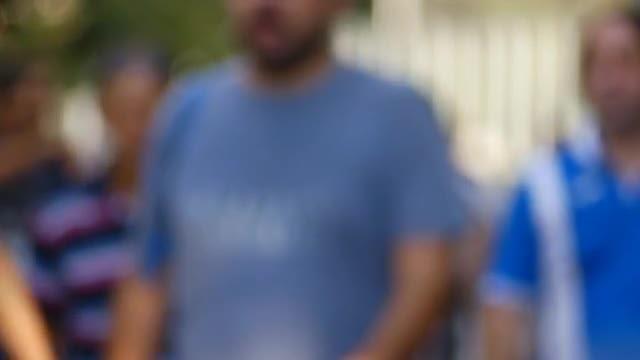 Walking People In Blue: Stock Video