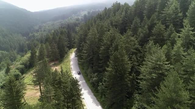Vehicle Plies Mountain Road: Stock Video