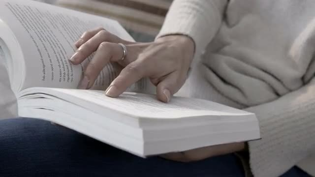 Close-up Shot Of Lady Reading: Stock Video