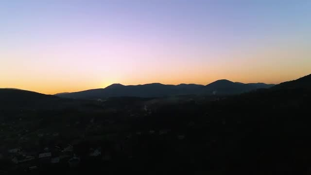 Sunset Over Village Silhouette: Stock Video