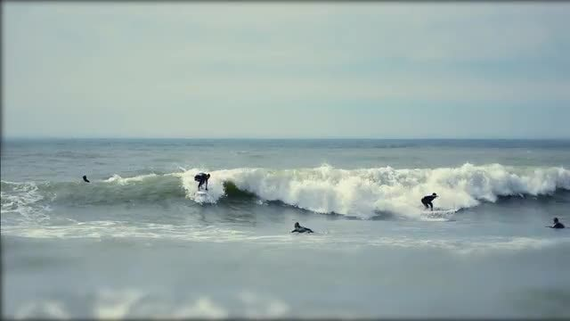 Tilt Shift Surfers Catching Waves: Stock Video