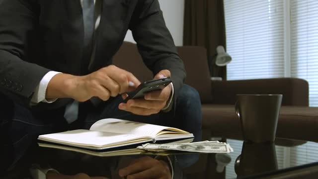Businessman Computing Money Total: Stock Video