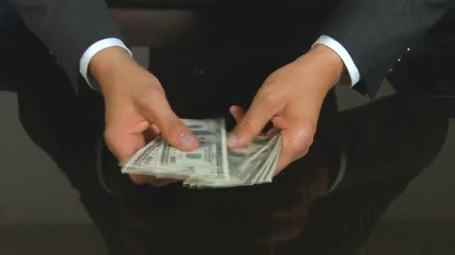 Man Counting New Dollar Bills: Stock Video