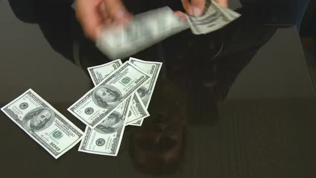 Male Hands Counting Dollar Bills: Stock Video