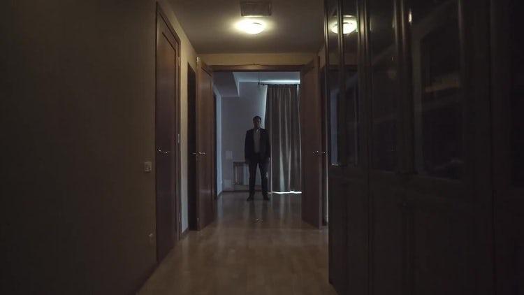 Stoic Man In Hallway: Stock Video