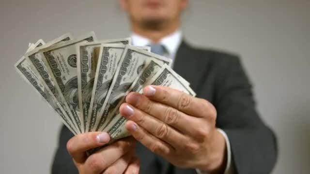 Businessman Showing Money To Camera: Stock Video