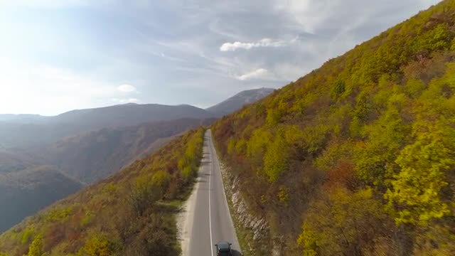 Car Driving Up A Mountain: Stock Video