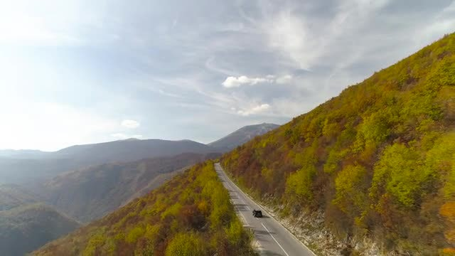 Mountain Road Aerial In Reverse: Stock Video