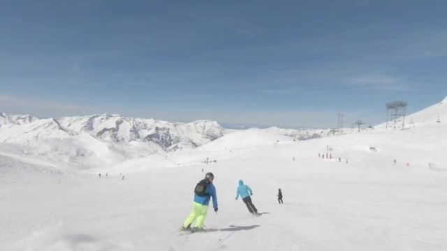 Alpine Skiers Going Downhill Quickly: Stock Video