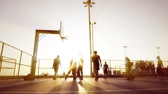 Basketball  Match During Sunset: Stock Video