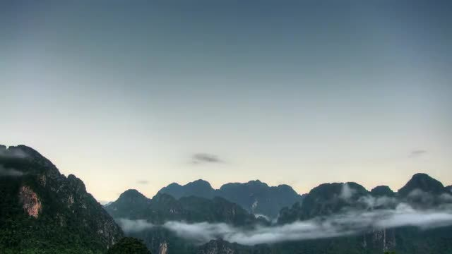 Swirling Clouds By The Mountains: Stock Video