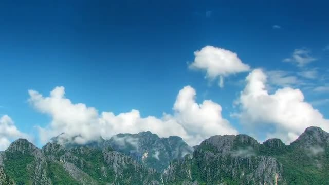 Clouds Puffing Over Mountains: Stock Video