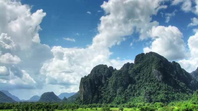 Puffy Cloudscape And Rock Formation: Stock Video
