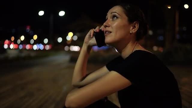 Woman Sitting On Street Pavement: Stock Video
