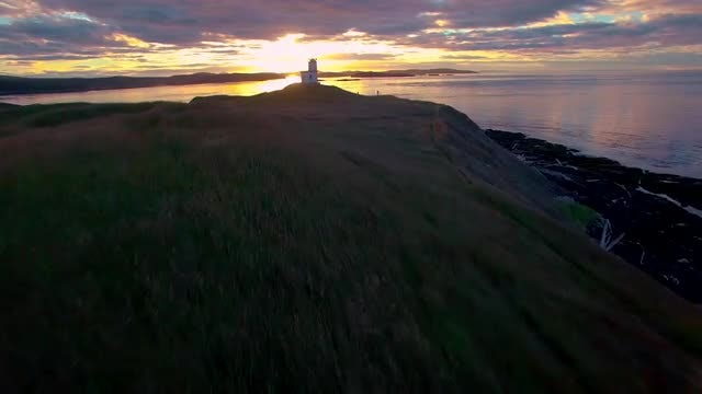 An Island Lighthouse At Sunrise: Stock Video