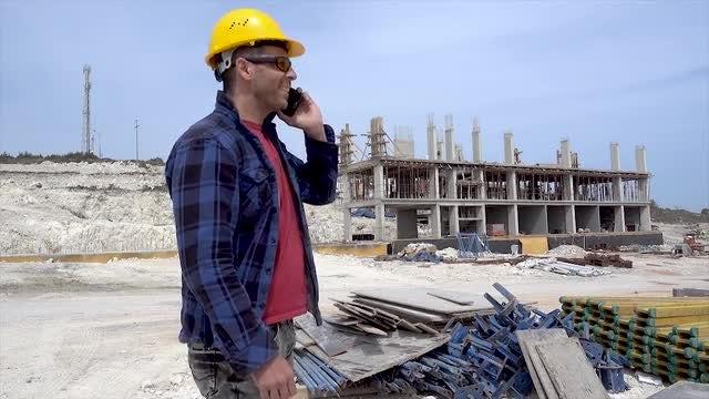 Engineer Talking On Smartphone: Stock Video