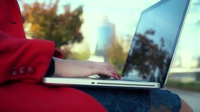 Woman Typing On A Laptop: Stock Video