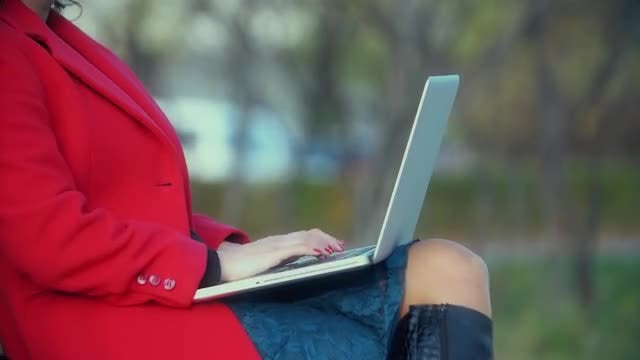 Girl Types On A Laptop: Stock Video
