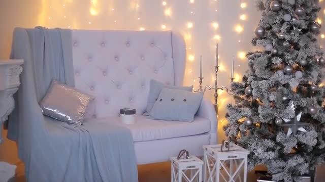 White Sofa With Christmas Tree: Stock Video