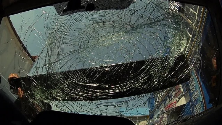 Masked Thug Vandalizing A Car: Stock Video