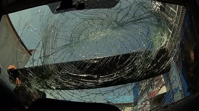 Masked Thug Vandalizing A Car: Stock Video