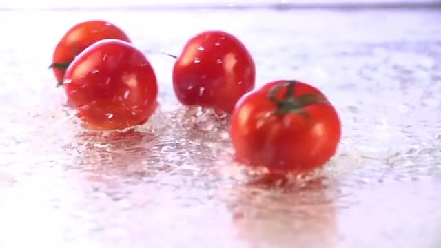 Tomatoes Rolling On Wet Floor: Stock Video