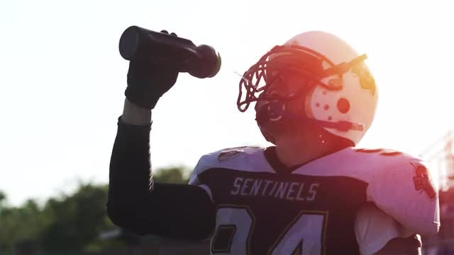 Football Player Drinking Water: Stock Video