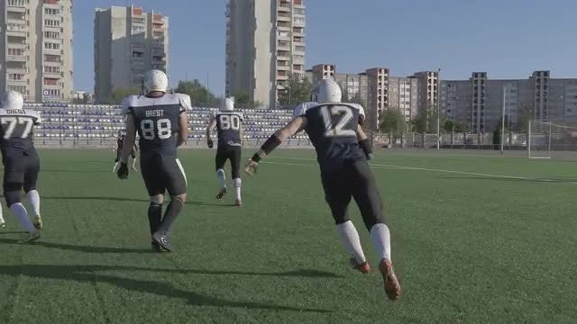 Football Players On The Field: Stock Video
