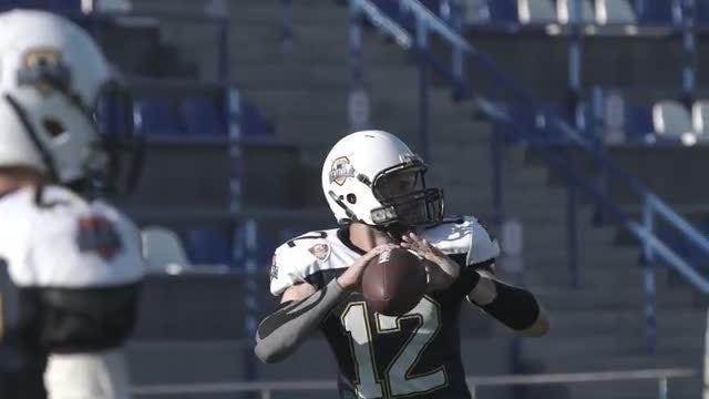 Football Player Throws Ball: Stock Video