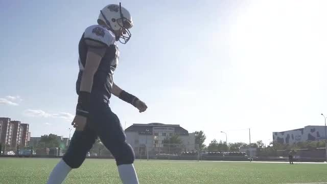 Football Player Crossing The Field: Stock Video