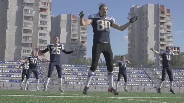 Football Team Trains Before Game: Stock Video