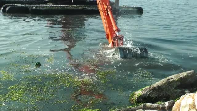 Garbage Excavator In The Sea: Stock Video