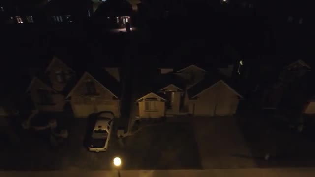Nighttime Aerial View Of Community: Stock Video