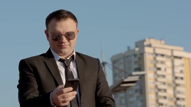 Businessman Using A Smartphone: Stock Video