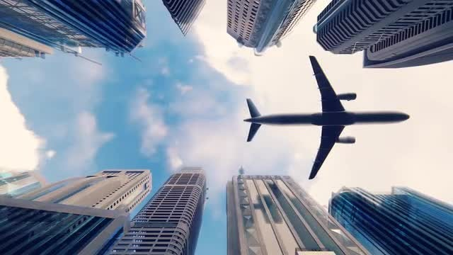 Airplane Flying Low Over City: Stock Motion Graphics