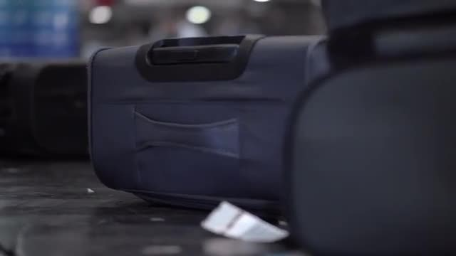 Luggage On Moving Conveyor Belt: Stock Video
