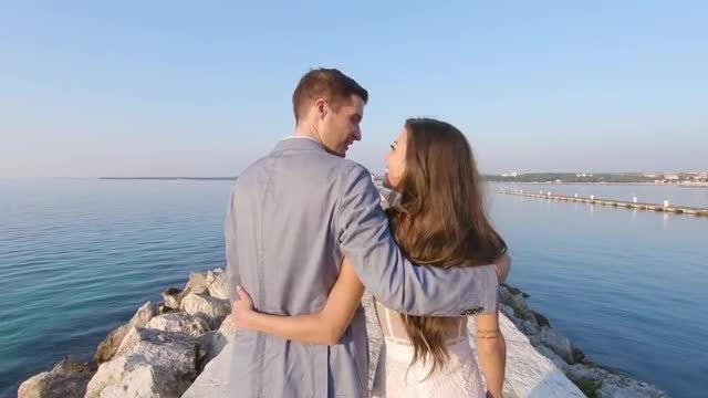 Beautiful Couple Walking By The Ocean: Stock Video
