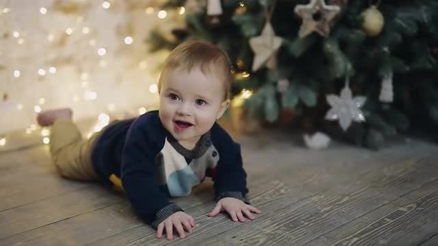 Happy Baby Is Enjoying Christmas: Stock Video