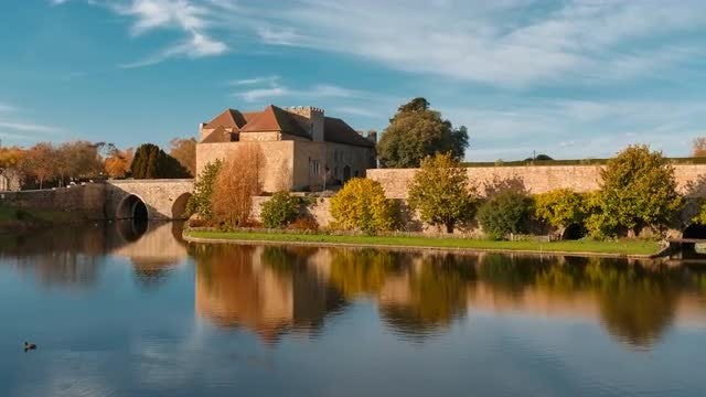 Medieval Castle Reflected On Moat: Stock Video