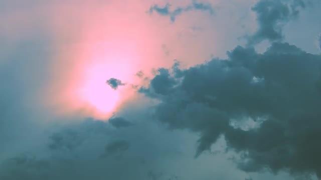 Majestic Sun Behind Dark Clouds: Stock Video