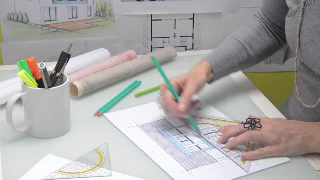 Female Architect Drawing Model House: Stock Video