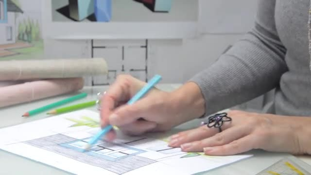 Drawing House In The Office: Stock Video