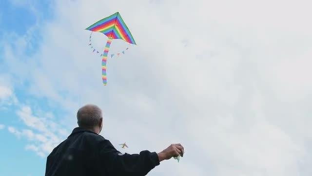 Man Flying A Kite: Stock Video
