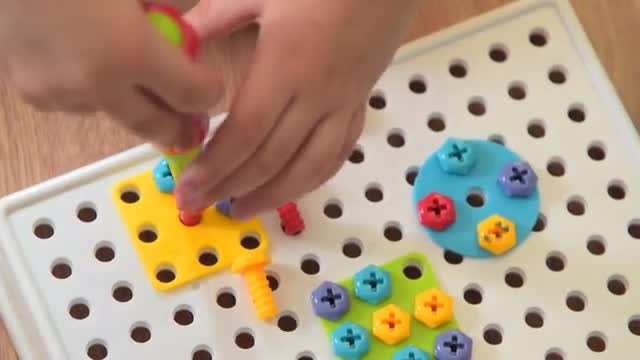 Child Playing With Screw Toys: Stock Video