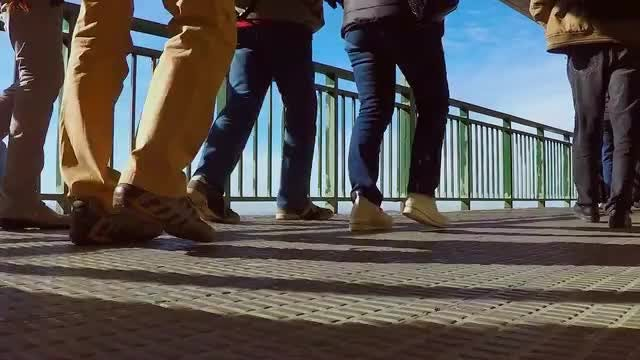 People Walking On Foot Bridge: Stock Video