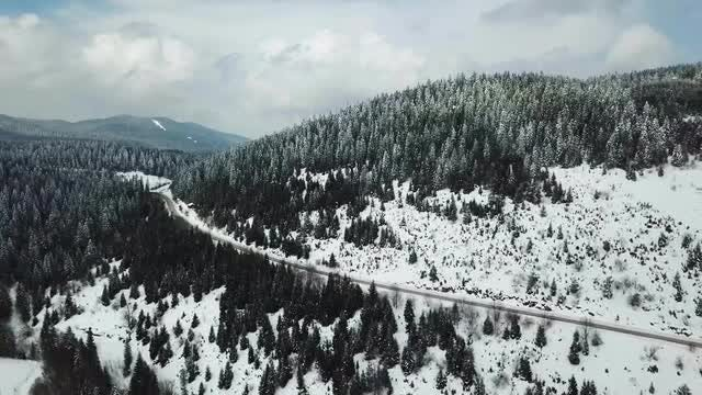Vehicles On Snowy Mountain Road: Stock Video