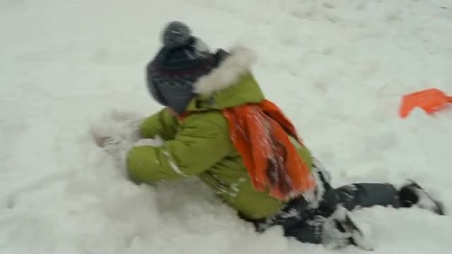 Child Crawling In Fresh Snow: Stock Video